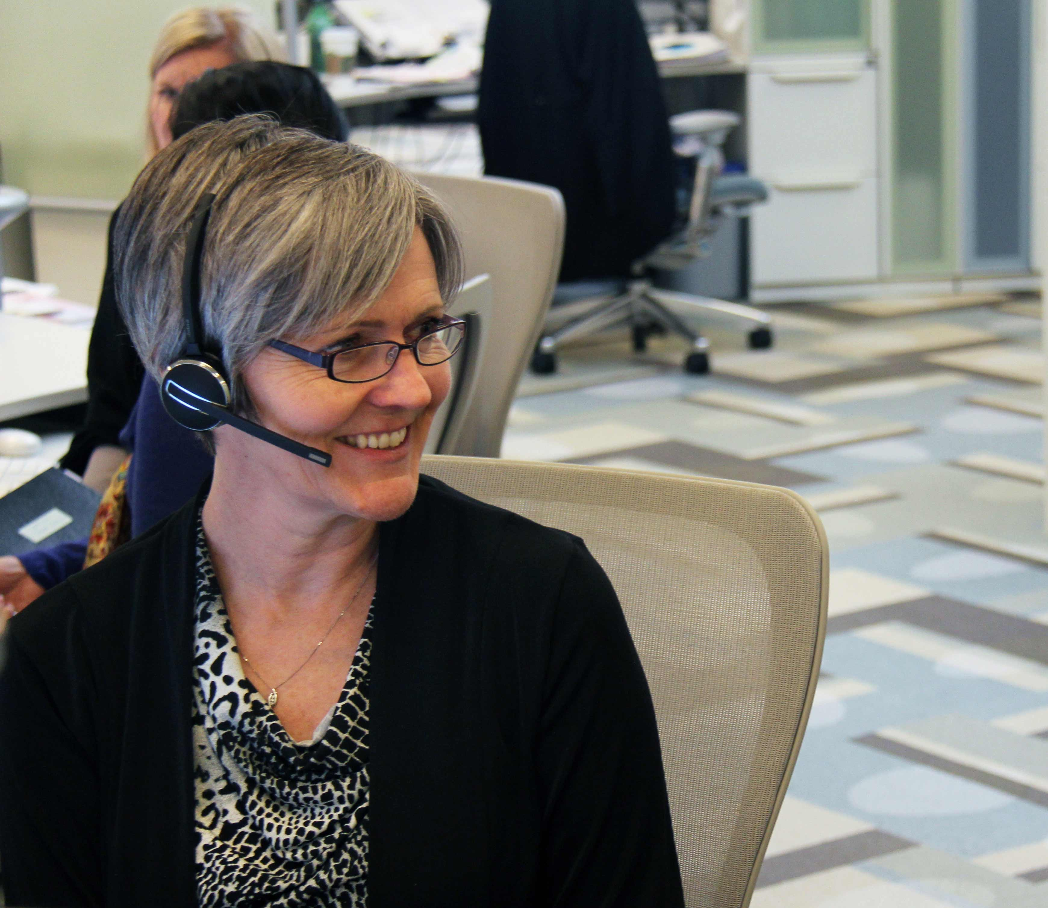 an employee of the office of the Ontario Ombudsman, wearing a headset