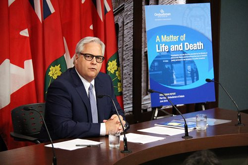 Ombudsman Paul Dubé at press conference for the release of the A Matter of Life and Death report