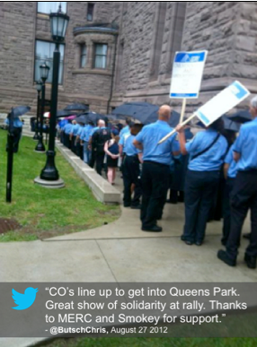 "Tweet: ""COs line up to get into Queen's Park. Great show of solidarity at rally. Thanks to MERC abd Smokey for support."" @ButschChris, August 27, 2012"