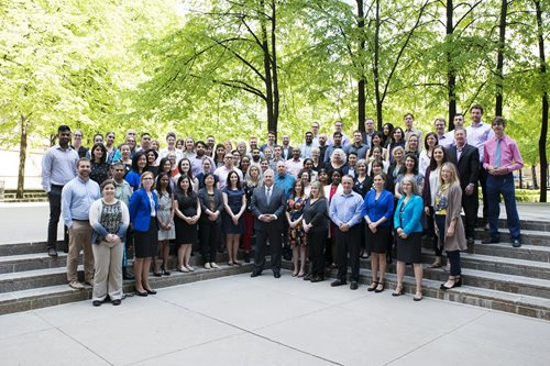 Members of staff of the Office of the Ontario Ombudsman posing for the picture, standing outside the office building.