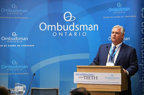 "Ombudsman Paul Dubé speaking during an edition of the ""Sharpening Your Teeth"" training."